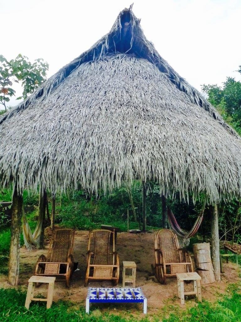The tambo outside of Chocopelli with chairs and hammocks