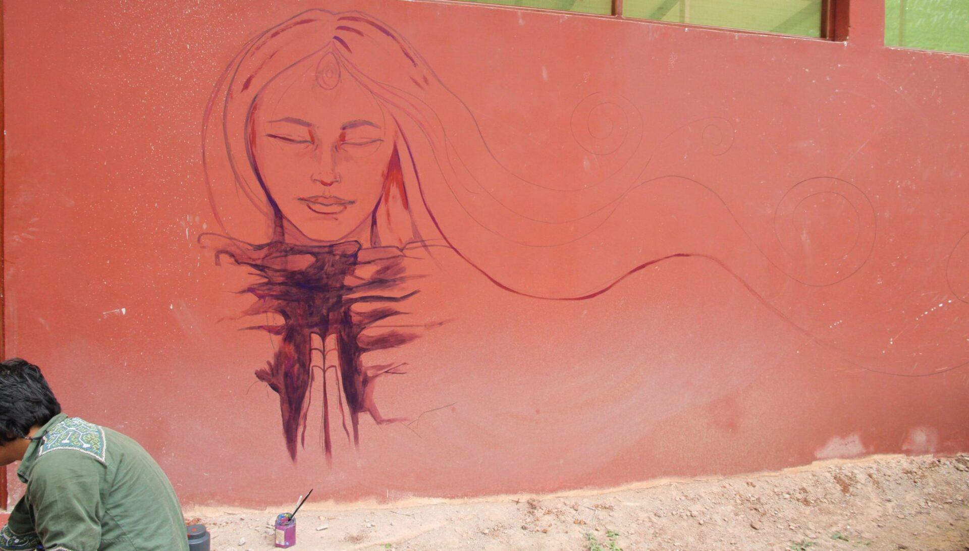 Juan Carlos Taminchi started off on his mural