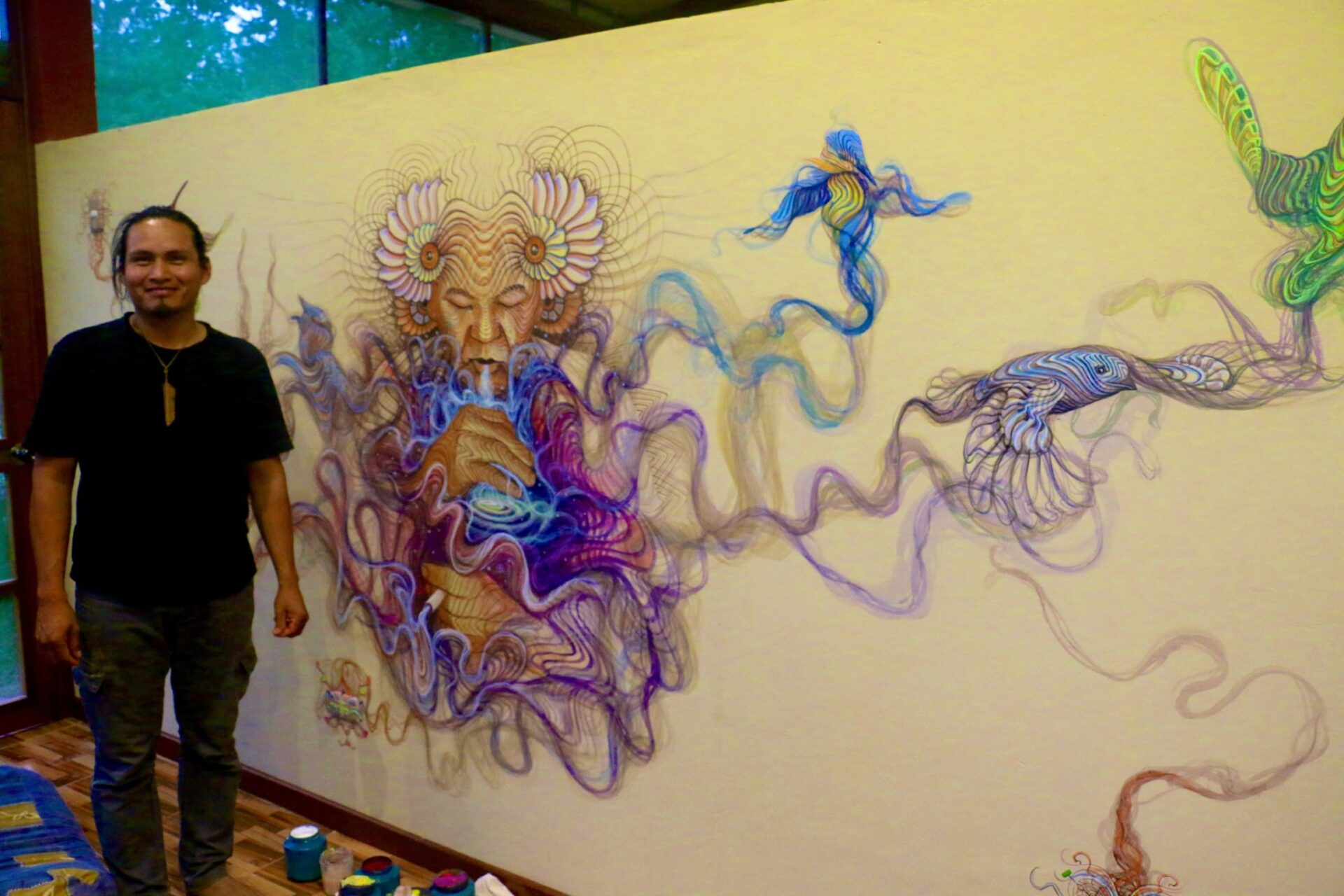 Luis Tamani with his finished mural