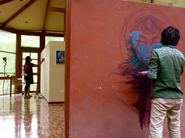 Juan Carlos Taminchi and Luis Tamani painting the walls of Chocopelli